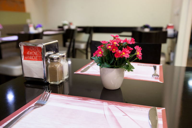 Restaurant table with pink flowers